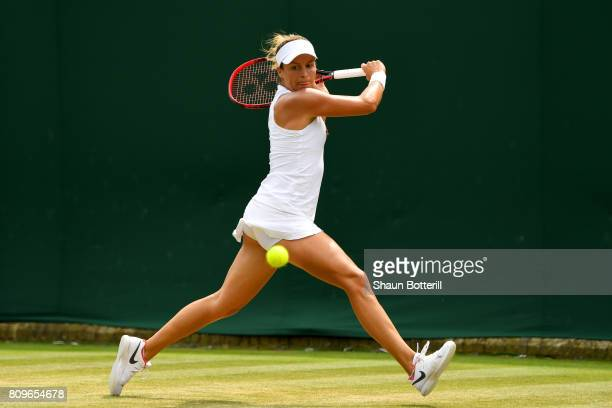 Tatjana Maria of Germany plays a backhand during the Ladies Singles second round match against Coco Vandeweghe of The United States on day four of...