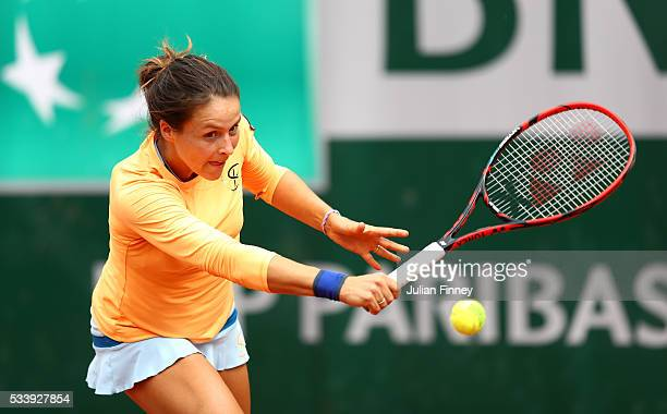 Tatjana Maria of Germany plays a backhand during the Women's Singles first round match against Jelena Jankovic of Serbia on day three of the 2016...