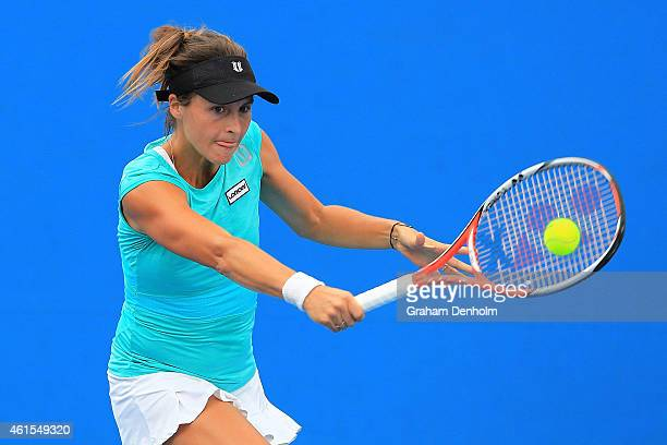 Tatjana Maria of Germany plays a backhand in her qualifying match against Gioia Barbieri of Italy for the 2015 Australian Open at Melbourne Park on...