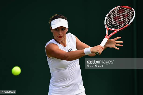 Tatjana Maria of Germany plays a backhand in her Women's Singles Second Round match against YingYing Duan of China during day four of the Wimbledon...