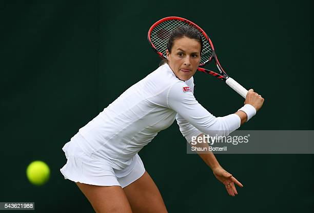Tatjana Maria of Germany plays a forehand during the Ladies Singles first round match against Julia Boserup of the United States on day three of the...