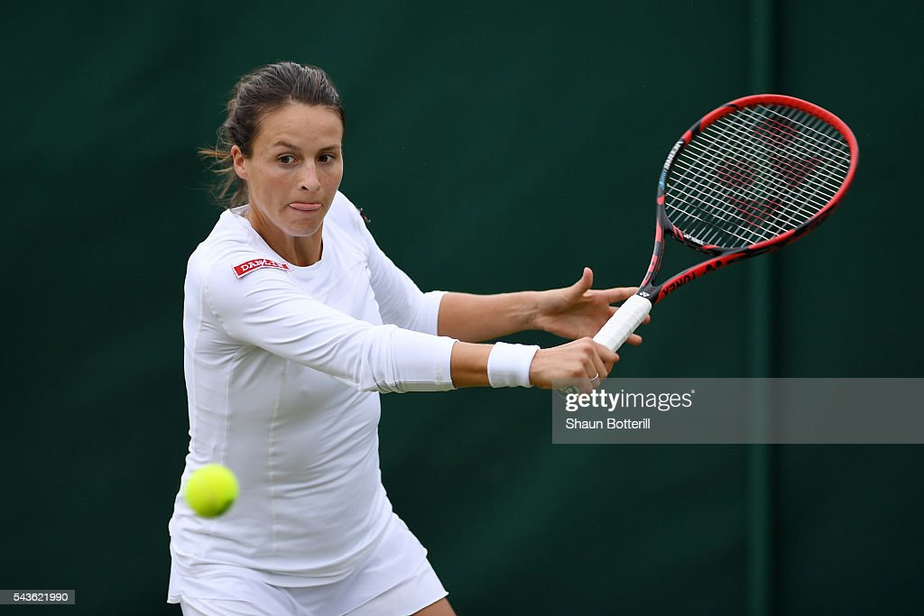 Tatjana Maria of Germany plays a forehand during the Ladies Singles first round match against Julia Boserup of the United States on day three of the Wimbledon Lawn Tennis Championships at the All England Lawn Tennis and Croquet Club on June 29, 2016 in London, England.