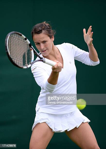 Tatjana Maria of Germany plays a forehand during the Ladies' Sipngles first round match against SuWei Hsieh of Taipei on day one of the Wimbledon...