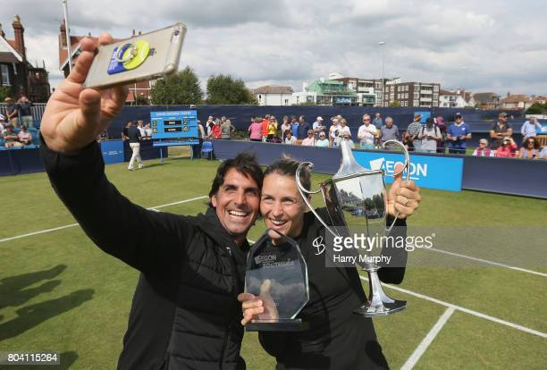 Tatjana Maria of Germany poses for a selfie with her husband and coach Charles Edouard Maria after the Aegon Southsea Trophy final match between...