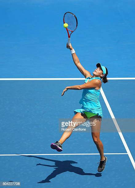 Tatjana Maria of Germany reaches for the ball in the women's doubles match against Kimberly Birrell of Australia and Jarmila Wolfe of Australia...