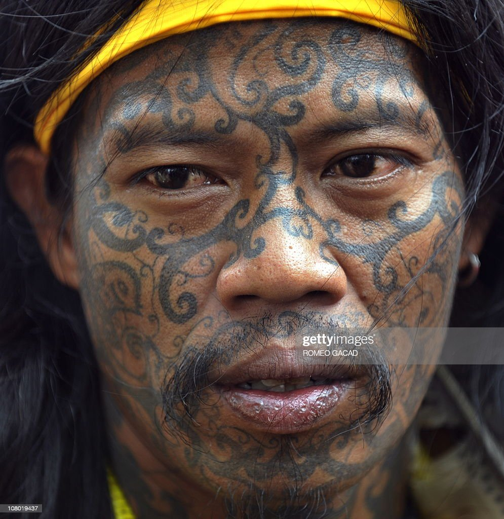 A tatooed Dayak tribesman from West Kalimantan in Borneo island participate in a protest by members of indeginous tribe in Jakarta on January 12, 2011. The group denounces University of Indonesian sociologist for allegedly offending the Dayak tribe in a remark in December regarding sexual practices made while he was a witness in a pornography case trial of an Indonesian rock star. The sociologist research on several Indonesian tribes and Dayak people stating that sex without marriage is acceptable has caused negative perception of the Dayak people according to the protesters.