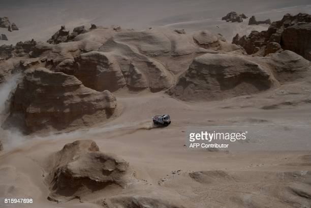 Tatra's Czech truck driver Martin Kolomy and Czech codrivers Jiri Stross and Michal Ernst compete during the Stage 9 of the Silk Way 2017 between...