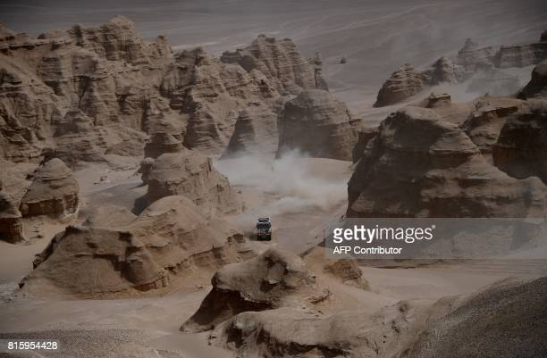 TOPSHOT Tatra's Czech truck driver Martin Kolomy and Czech codrivers Jiri Stross and Michal Ernst compete during the Stage 9 of the Silk Way 2017...