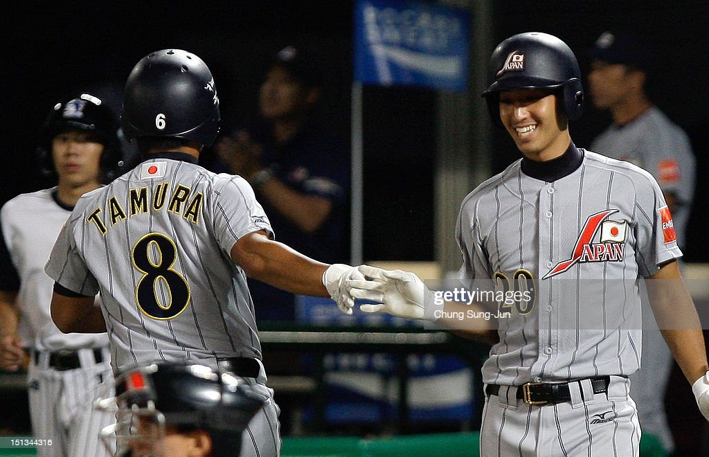 Tatsuhiro Tamura of Japan is congratulated by Gen Mizumoto during the match between Japan and South Korea on day two of the U18 Baseball World Championship at Mokdong Stadium on September 6, 2012 in Seoul, South Korea.