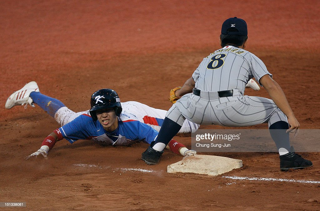 Tatsuhiro Tamura of Japan tags out as Yoo Young-Jun of South Korea slides into third base in the third inning during the U18 Baseball World Championship match between Japan and South Korea at Mokdong Stadium on September 6, 2012 in Seoul, South Korea.