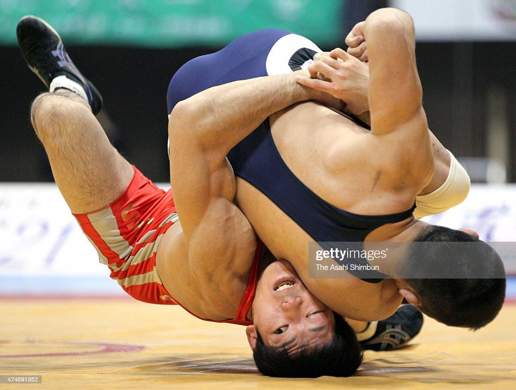 Tatsuhiro Yonemitsu and Kazuhiko Ikematsu compete in the Men's Freestyle 66kg final during day two of the All Japan Wrestling Championships at Yoyogi...