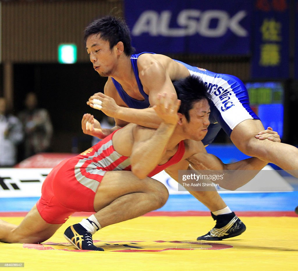 Tatsuhiro Yonemitsu and Takafumi Kojima compete in the Men's Freestyle 66kg final during day one of the All Japan Wrestling Championships at Yoyogi...