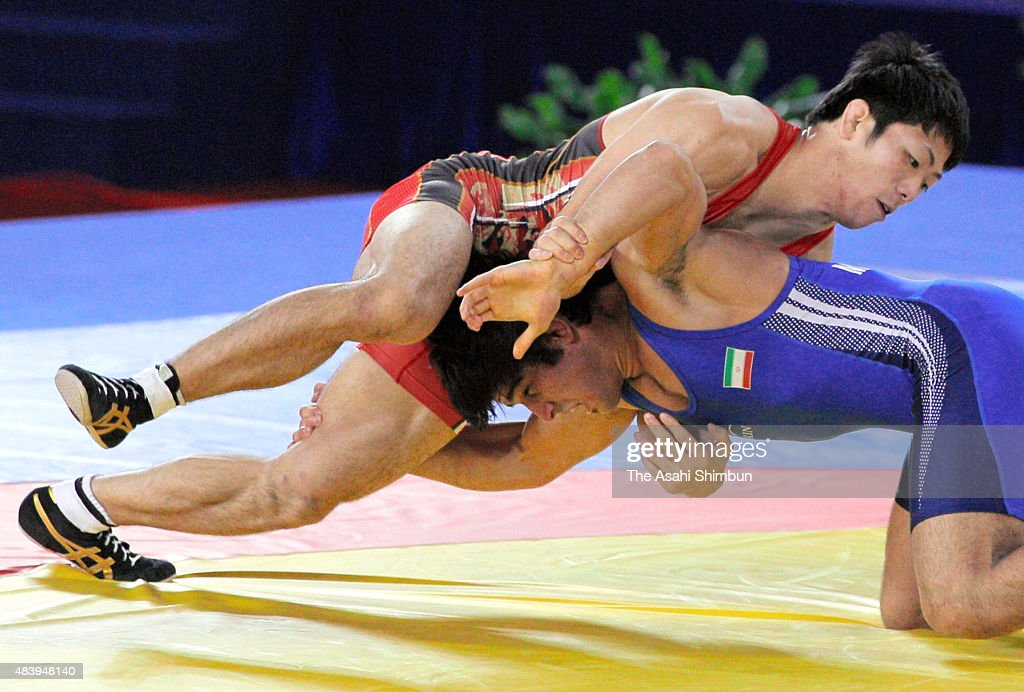 Tatsuhiro Yonemitsu of Japan and Mehdi Taghavi of Iran compete in the Wrestling Men's Freestyle 66kg final during day twelve of the Guangzhou Asian...