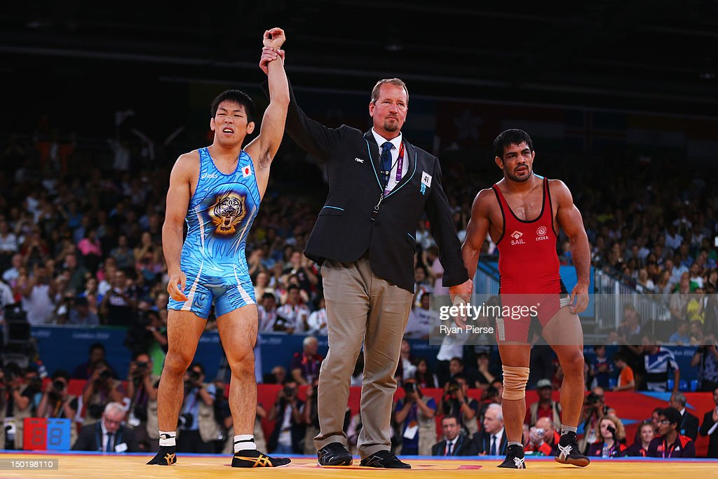Tatsuhiro Yonemitsu of Japan celebrates his victory against Sushil Kumar of India during the Men's Freestyle 66 kg Wrestling gold medal fight on Day...
