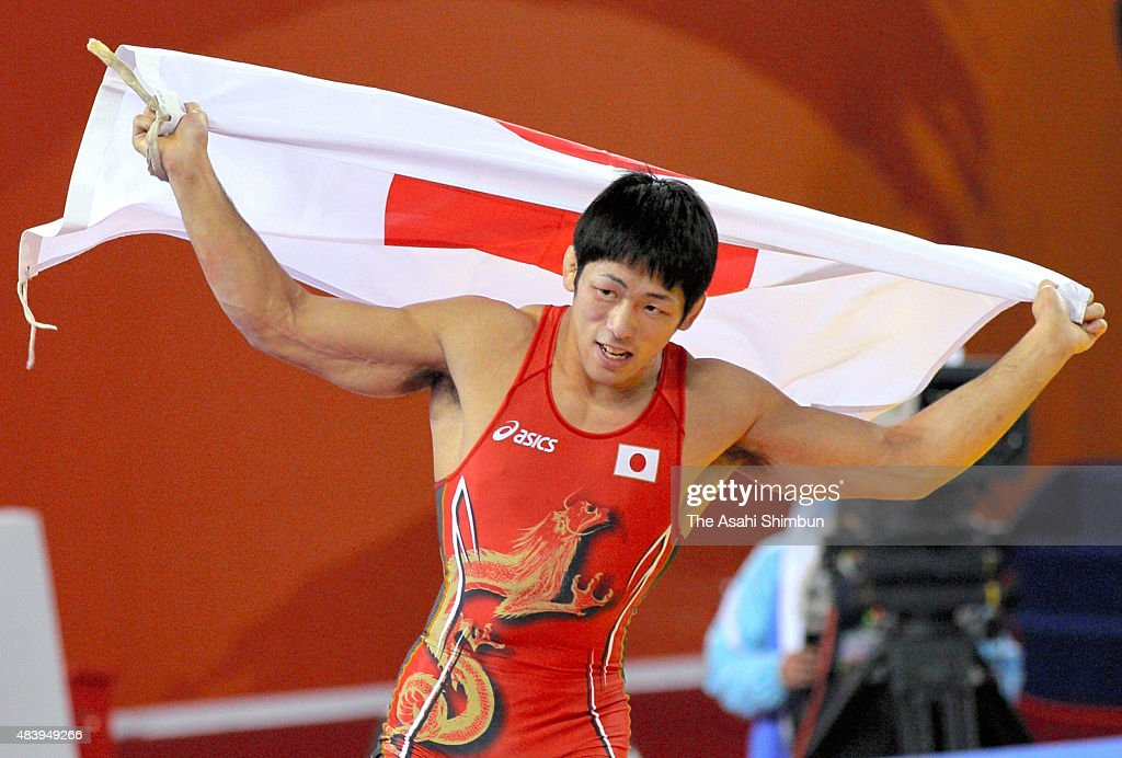 Tatsuhiro Yonemitsu of Japan celebrates winning the gold medal in the Wrestling Men's Freestyle 66kg final during day twelve of the Guangzhou Asian...