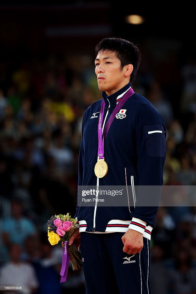 Tatsuhiro Yonemitsu of Japan celebrates with his gold medal during the medal ceremony following the Men's Freestyle 66 kg Wrestling gold medal fight...
