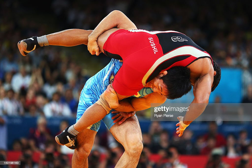 Tatsuhiro Yonemitsu of Japan in action against against Sushil Kumar of India during the Men's Freestyle 66 kg Wrestling gold medal fight on Day 16 of...