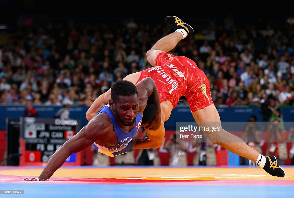 Tatsuhiro Yonemitsu of Japan in action against Haislan Veranes Garcia of Canada in the Men's Freestyle Wrestling 66kg Quarter final match on Day 16...