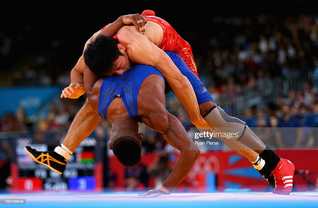 Tatsuhiro Yonemitsu of Japan in action against Livan Lopez Azcuy of Cuba in the Men's Freestyle Wrestling 66kg 1/8 final match on Day 16 of the...