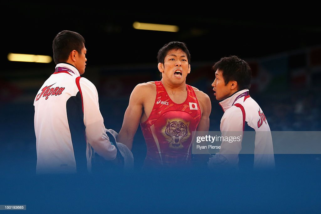 Tatsuhiro Yonemitsu of Japan looks on during his bout with Livan Lopez Azcuy of Cuba in the Men's Freestyle Wrestling 66kg 1/8 final match on Day 16...
