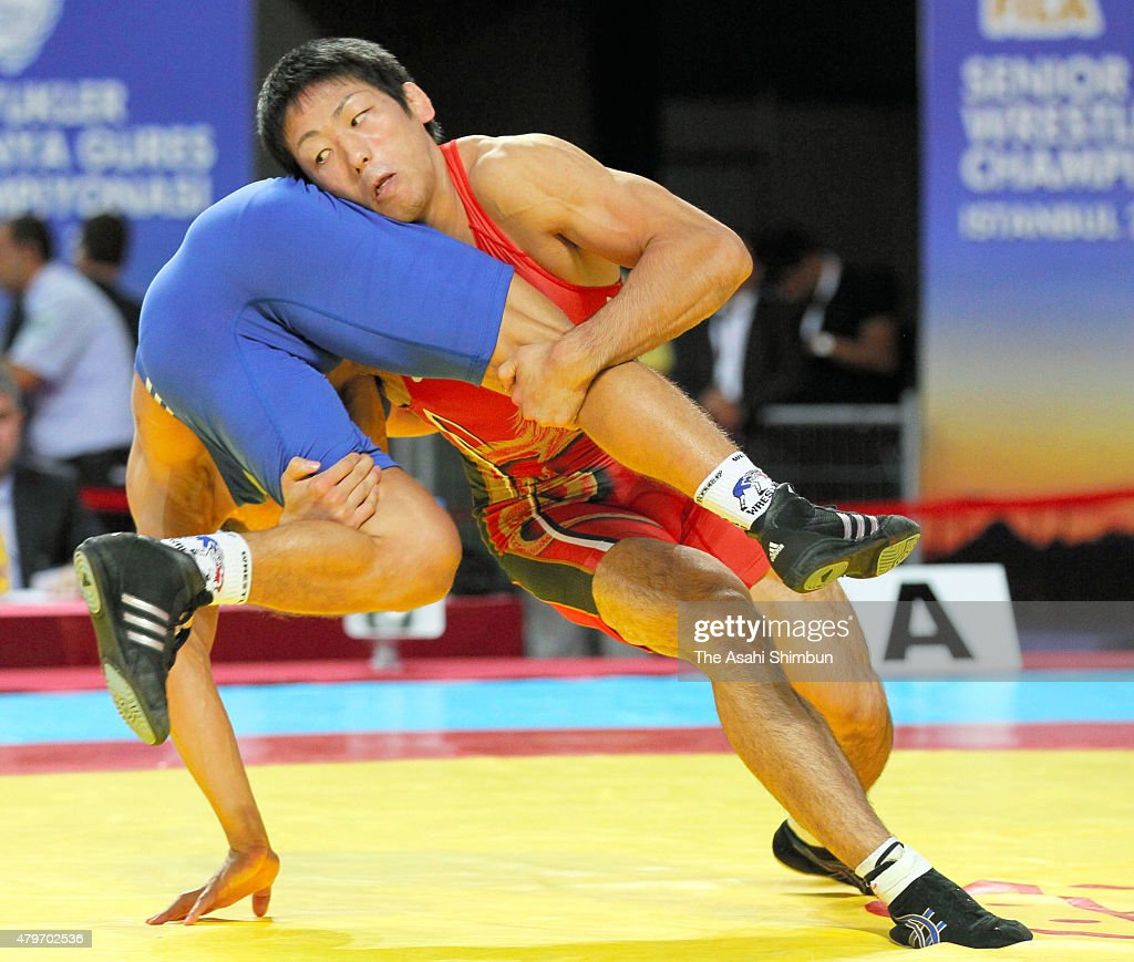 Tatsuhiro Yonemitsu of Japan throws Leonid Bazan of Bulgaria in the Men's Freestyle 66kg semifinal match during day seven of the 2011 FILA World...