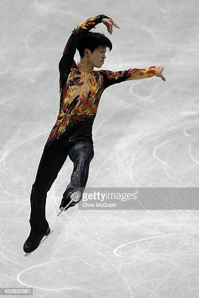 Tatsuki Machida of Japan competes in the Men's Free Skating Final on day two of the ISU Grand Prix of Figure Skating Final 2013/2014 at Marine Messe...