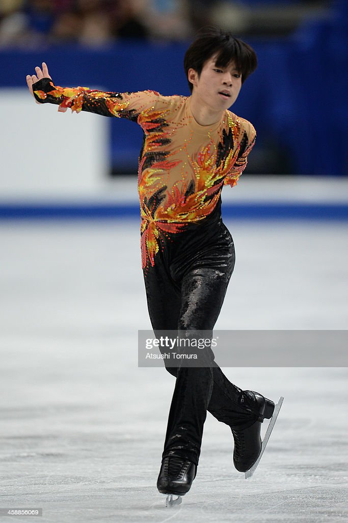 <a gi-track='captionPersonalityLinkClicked' href=/galleries/search?phrase=Tatsuki+Machida&family=editorial&specificpeople=4532357 ng-click='$event.stopPropagation()'>Tatsuki Machida</a> of Japan performs in the men's free skating during All Japan Figure Skating Championships at Saitama Super Arena on December 22, 2013 in Saitama, Japan.