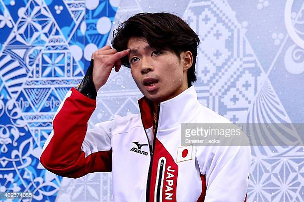 Tatsuki Machida of Japan reacts after he competes during the Figure Skating Men's Free Skating on day seven of the Sochi 2014 Winter Olympics at...