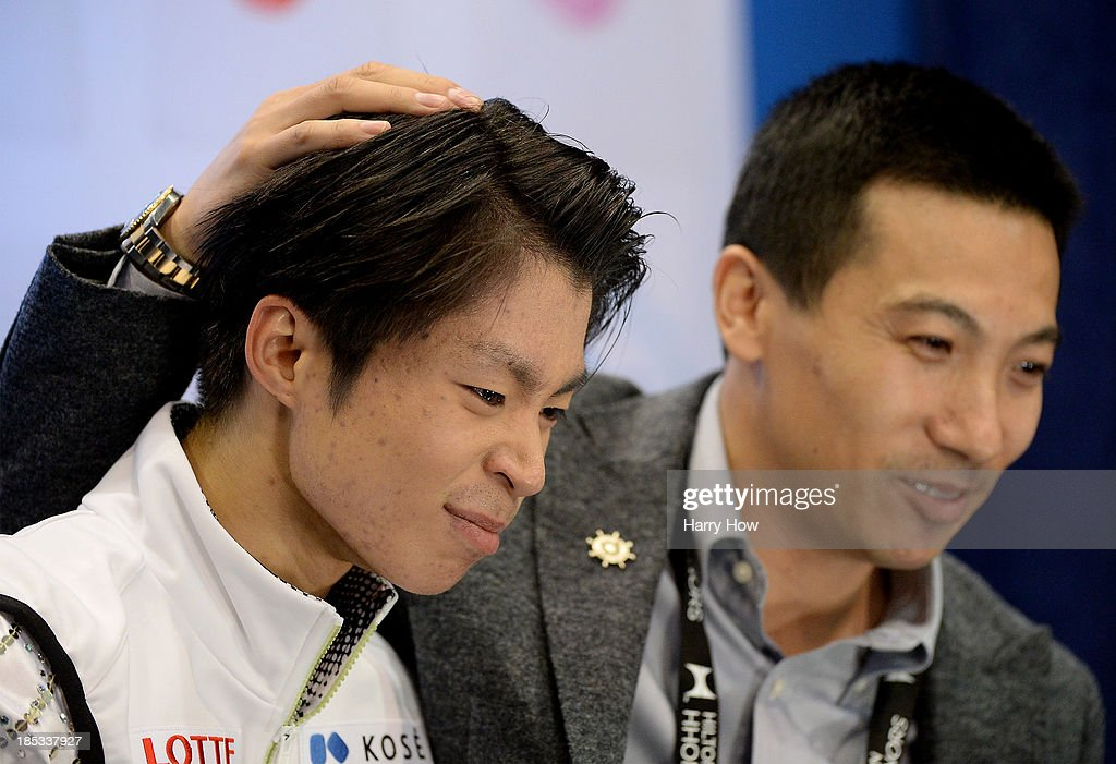 <a gi-track='captionPersonalityLinkClicked' href=/galleries/search?phrase=Tatsuki+Machida&family=editorial&specificpeople=4532357 ng-click='$event.stopPropagation()'>Tatsuki Machida</a> of Japan reacts after his skate with coach <a gi-track='captionPersonalityLinkClicked' href=/galleries/search?phrase=Anthony+Liu&family=editorial&specificpeople=2775953 ng-click='$event.stopPropagation()'>Anthony Liu</a> of Australia during the men's short program at Skate America 2013 at Joe Louis Arena on October 18, 2013 in Detroit, Michigan.