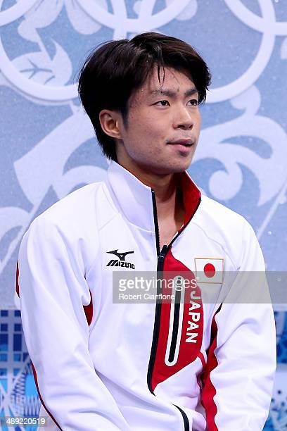 Tatsuki Machida of Japan waits for his score after competing during the Men's Figure Skating Short Program on day 6 of the Sochi 2014 Winter Olympics...