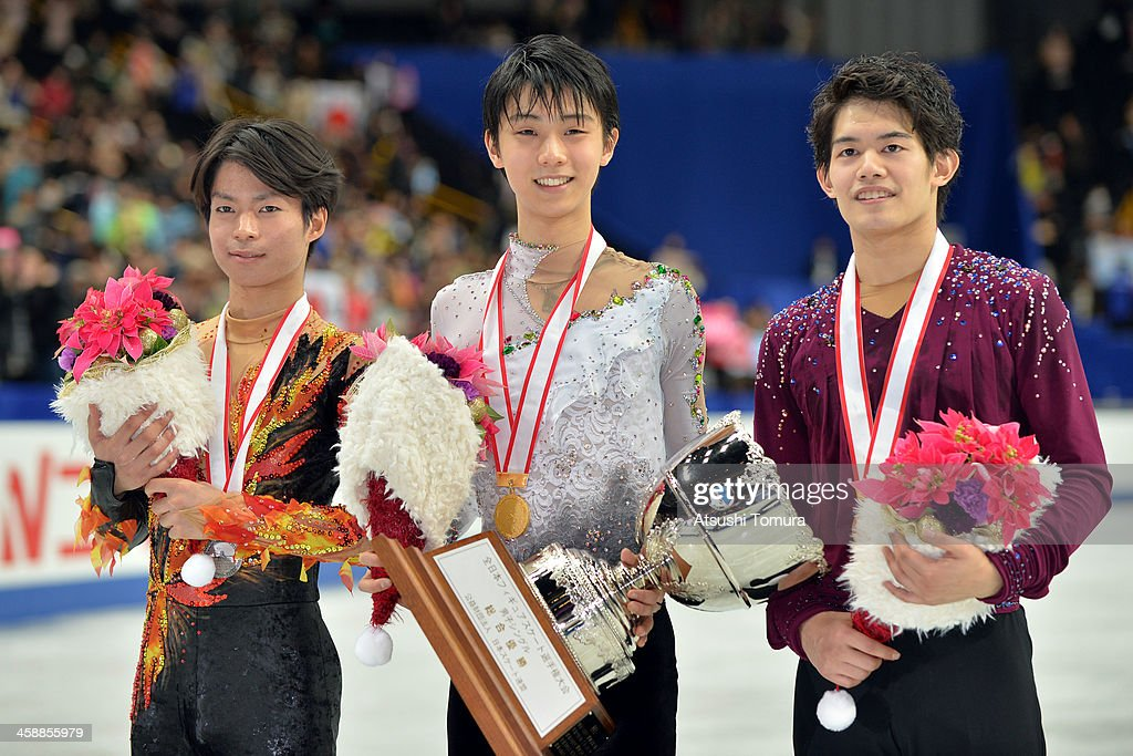 Tatsuki Machida of Japan, Yuzuru Hanyu of Japan and Takahiko Kozuka of Japan pose with their medals in the men's single victory ceremony during All Japan Figure Skating Championships at Saitama Super Arena on December 22, 2013 in Saitama, Japan.