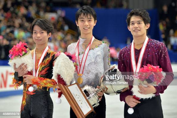 Tatsuki Machida of Japan Yuzuru Hanyu of Japan and Takahiko Kozuka of Japan pose with their medals in the men's single victory ceremony during All...