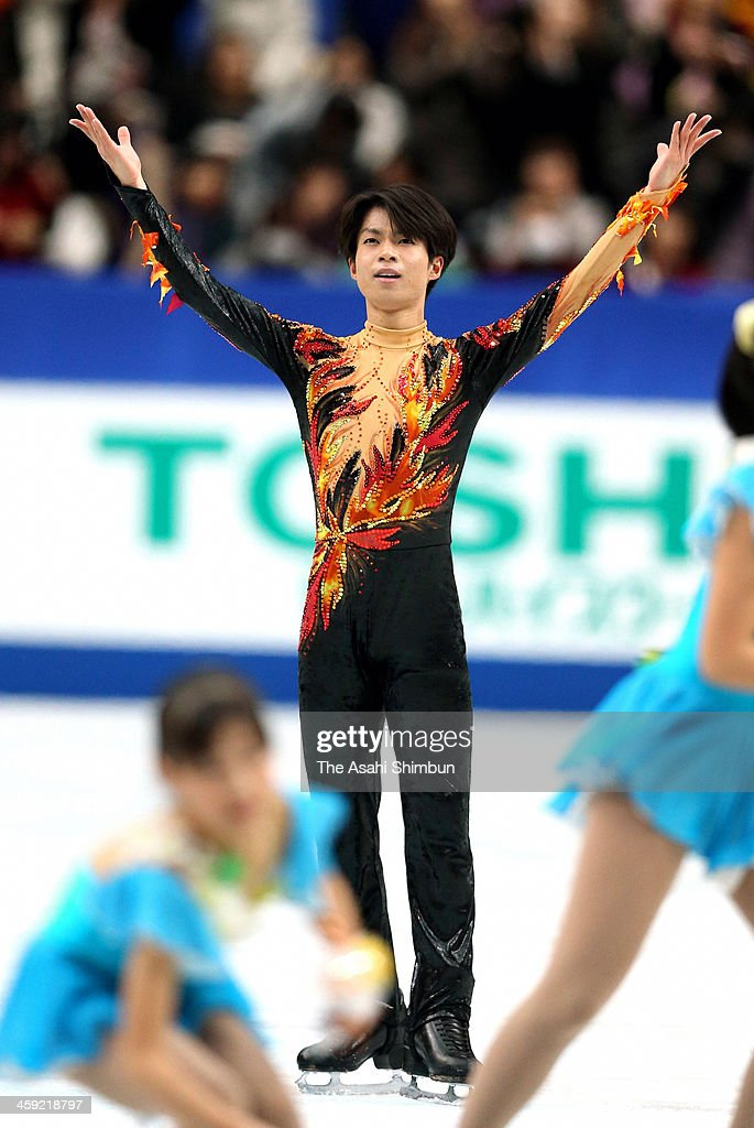 Tatsuki Machida reacts after competing in the Men's Singles Free Program during the 82nd All Japan Figure Skating Championships at Saitama Super Arena on December 22, 2013 in Saitama, Japan.