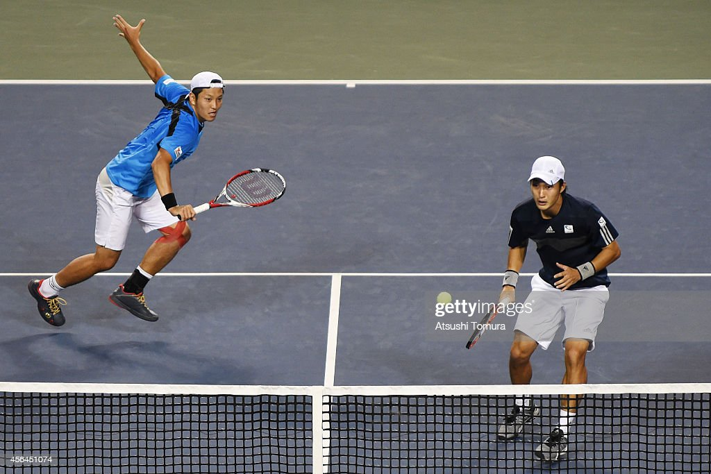 Tatsuma Ito and Go Soeda of Japan in action during the men's doubles first round match against Rohan Bopanna and Leander Paes of India on day three of Rakuten Open 2014 at Ariake Colosseum on October 1, 2014 in Tokyo, Japan.