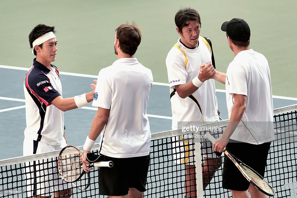 Tatsuma Ito (L-3) and <a gi-track='captionPersonalityLinkClicked' href=/galleries/search?phrase=Kei+Nishikori&family=editorial&specificpeople=4432498 ng-click='$event.stopPropagation()'>Kei Nishikori</a> (L-1) of Japan shake hands with <a gi-track='captionPersonalityLinkClicked' href=/galleries/search?phrase=Alexander+Peya&family=editorial&specificpeople=647128 ng-click='$event.stopPropagation()'>Alexander Peya</a> of Austria and <a gi-track='captionPersonalityLinkClicked' href=/galleries/search?phrase=Christopher+Kas&family=editorial&specificpeople=987913 ng-click='$event.stopPropagation()'>Christopher Kas</a> of Germany after winning first round doubles match during the day one of the Rakuten Open at Ariake Colosseum on October 3, 2011 in Tokyo, Japan.