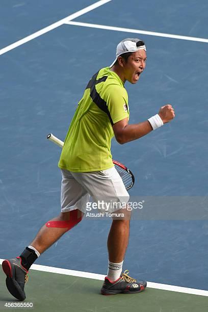 Tatsuma Ito of Japan celebrates after winning the men's singles first round match against Stan Wawrinka of Switzerland on day two of Rakuten Open...