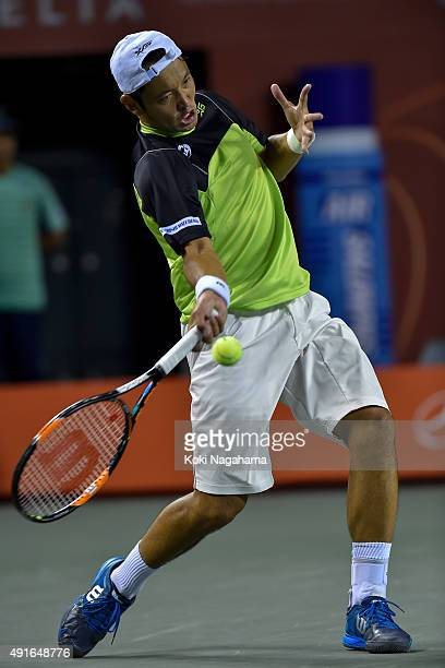 Tatsuma Ito of Japan competes against Stan Wawrinka of Switzerland during the men's singles second round match on day three of Rakuten Open 2015 at...