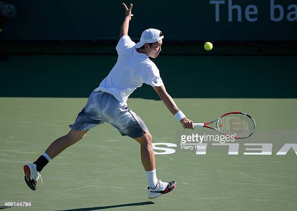 Tatsuma Ito of Japan hits a backhand in his match against Malek Jaziri of Tunisia during the BNP Parisbas Open at the Indian Wells Tennis Garden on...