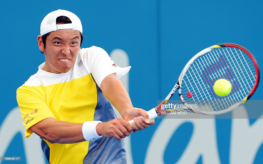 Tatsuma Ito of Japan hits a backhand return during his loss to John Millman of Australia in their first round men's singles match at the Brisbane International tennis tournament on January 1, 2013. AFP PHOTO/William WEST IMAGE