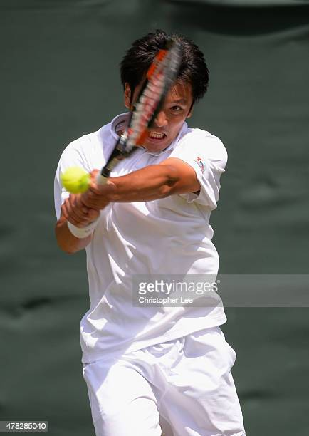 Tatsuma Ito of Japan in action against Hiroki Moriya of Japan in the Gentlemens Second Round during the 2015 Wimbledon Qualifying Session on June 24...