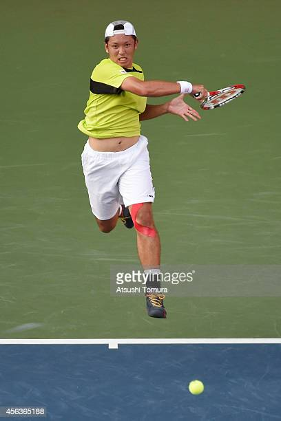 Tatsuma Ito of Japan in action during the men's singles first round match against Stan Wawrinka of Switzerland on day two of Rakuten Open 2014 at...
