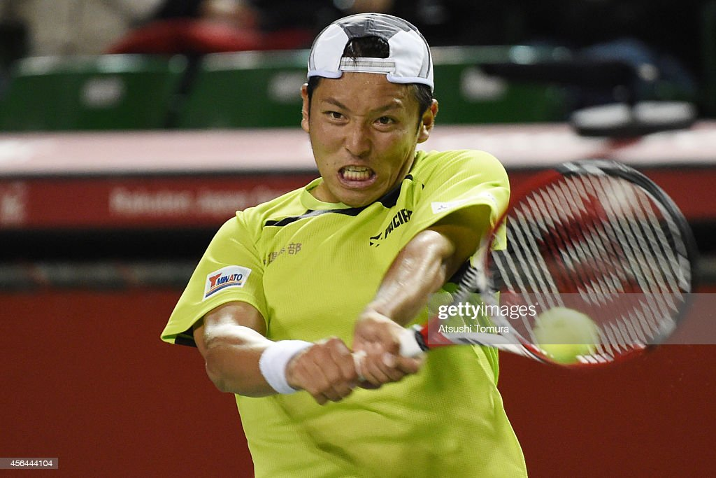 <a gi-track='captionPersonalityLinkClicked' href=/galleries/search?phrase=Tatsuma+Ito&family=editorial&specificpeople=5545179 ng-click='$event.stopPropagation()'>Tatsuma Ito</a> of Japan in action during the men's singles second round match against Benjamin Becker of Germany on day three of Rakuten Open 2014 at Ariake Colosseum on October 1, 2014 in Tokyo, Japan.