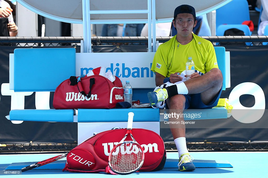<a gi-track='captionPersonalityLinkClicked' href=/galleries/search?phrase=Tatsuma+Ito&family=editorial&specificpeople=5545179 ng-click='$event.stopPropagation()'>Tatsuma Ito</a> of Japan looks on in his first round match against Martin Klizan of Slovakia during day one of the 2015 Australian Open at Melbourne Park on January 19, 2015 in Melbourne, Australia.