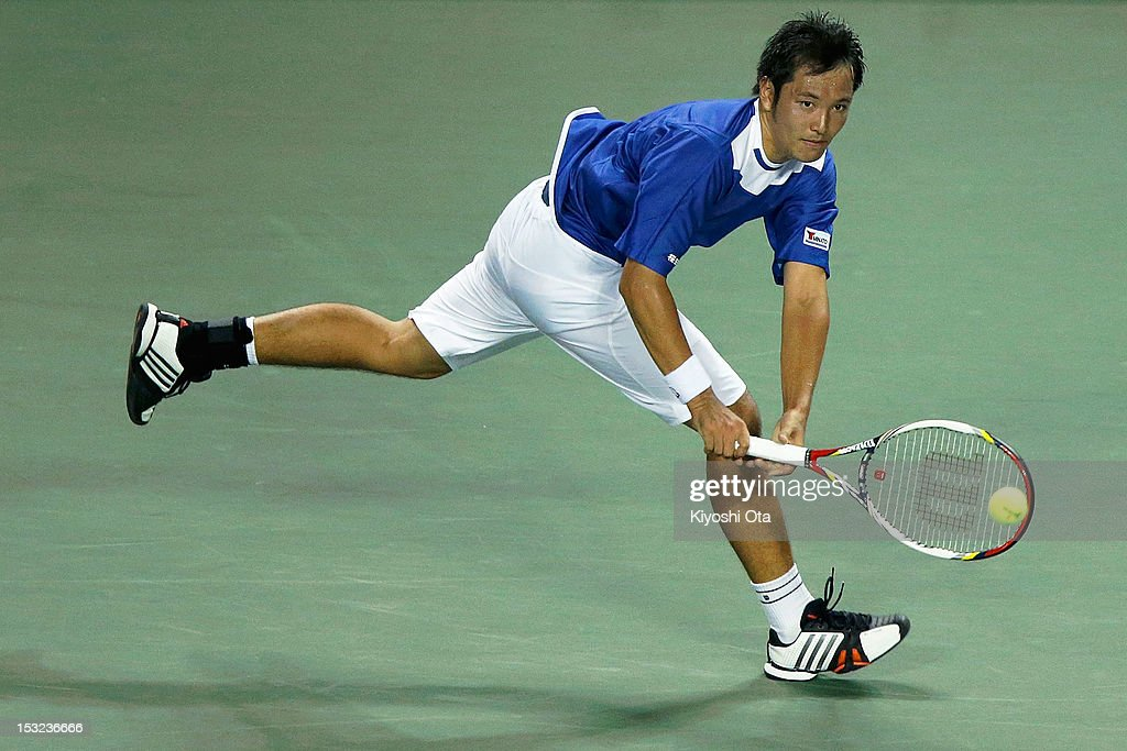 Tatsuma Ito of Japan plays a backhand in his first round match against Nicolas Almagro of Spain during day two of the Rakuten Open at Ariake Colosseum on October 2, 2012 in Tokyo, Japan.