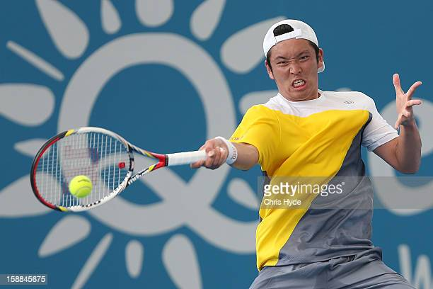 Tatsuma Ito of Japan plays a forehand during his match against John Millman of Australia on day three of the Brisbane International at Pat Rafter...