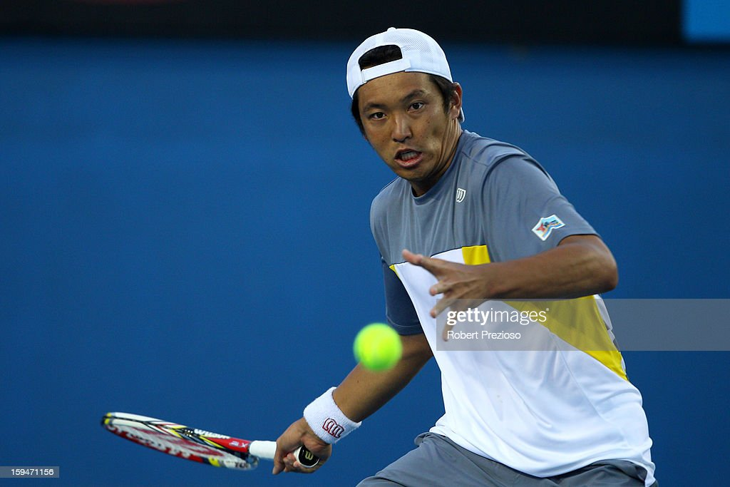 Tatsuma Ito of Japan plays a forehand in his first round match against John Millman of Australia during day one of the 2013 Australian Open at Melbourne Park on January 14, 2013 in Melbourne, Australia.