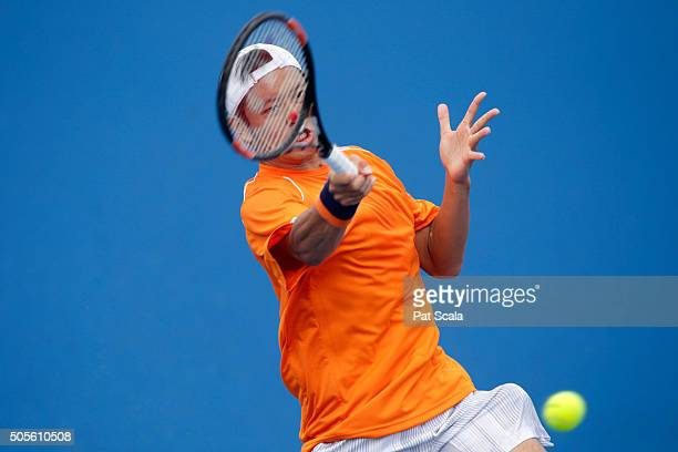 Tatsuma Ito of Japan plays a forehand in his first round match against Radek Stepanek of Czech Republic during day two of the 2016 Australian Open at...