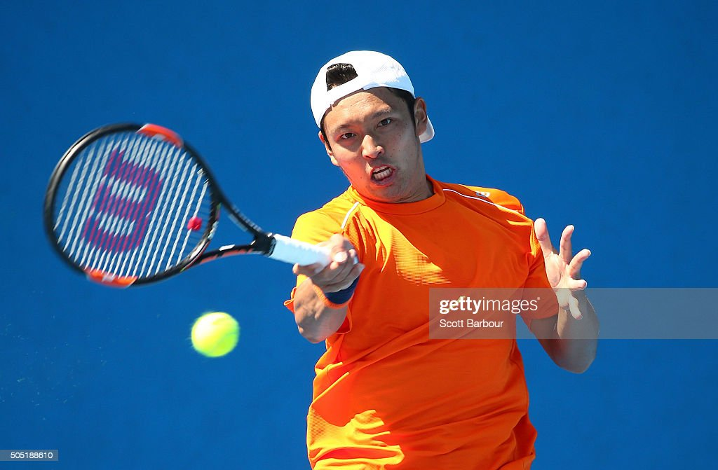 Tatsuma Ito of Japan plays a forehand in his match against Adrian Menendez-Maceiras of Spain during the third round of 2016 Australian Open Qualifying at Melbourne Park on January 16, 2016 in Melbourne, Australia.