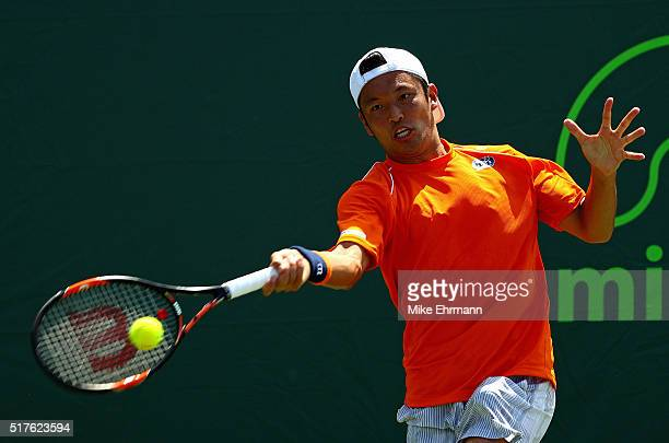 Tatsuma Ito of Japan plays a match against Gael Monfils of France during Day 6 of the Miami Open presented by Itau at Crandon Park Tennis Center on...
