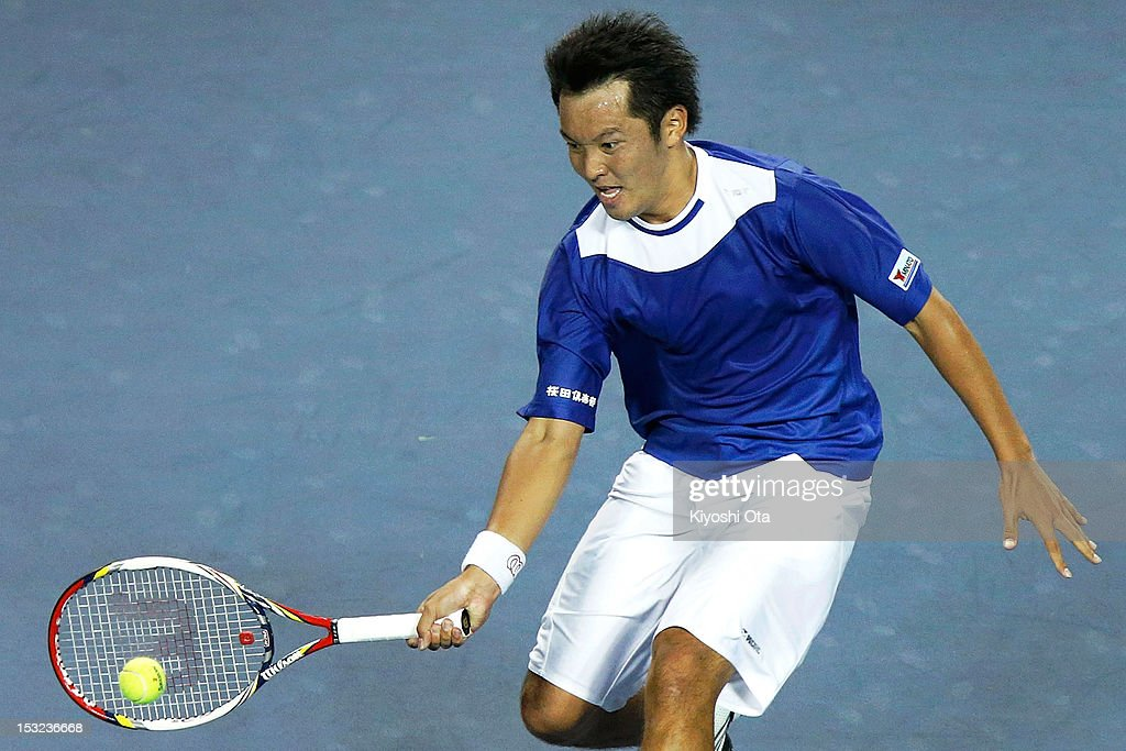 <a gi-track='captionPersonalityLinkClicked' href=/galleries/search?phrase=Tatsuma+Ito&family=editorial&specificpeople=5545179 ng-click='$event.stopPropagation()'>Tatsuma Ito</a> of Japan plays in his first round match against Nicolas Almagro of Spain during day two of the Rakuten Open at Ariake Colosseum on October 2, 2012 in Tokyo, Japan.